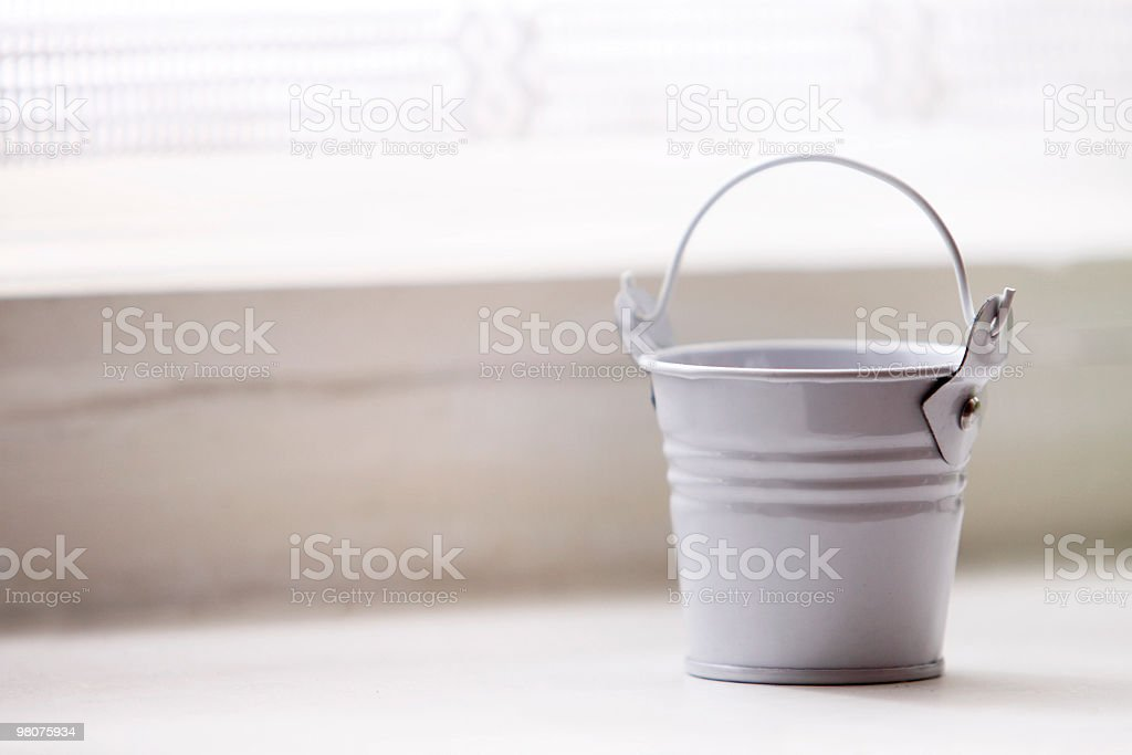 Small Bucket on Window Sill royalty-free stock photo
