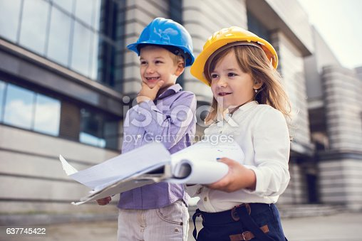 643843490istockphoto Small building contractors with a business plan outdoors. 637745422