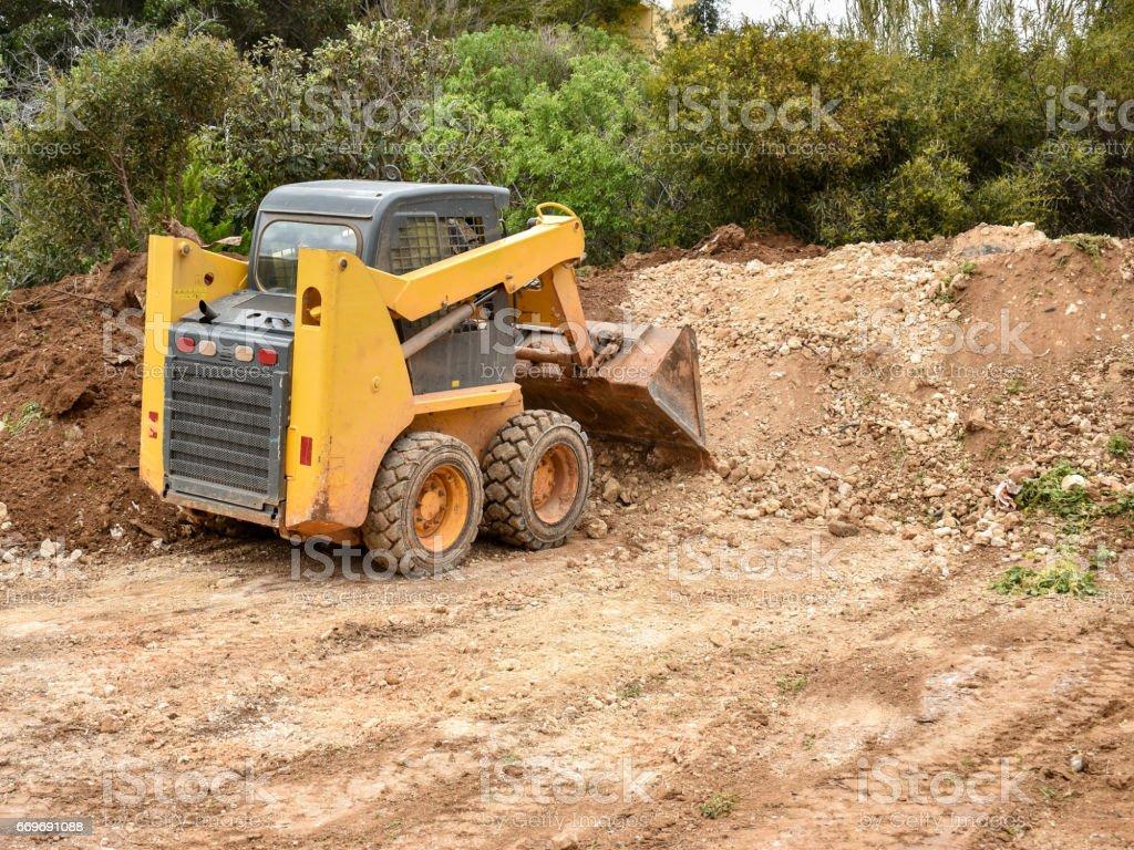 Small bulldozer stock photo