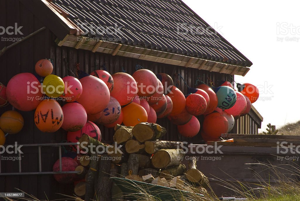 Small Buoys on Side of House stock photo