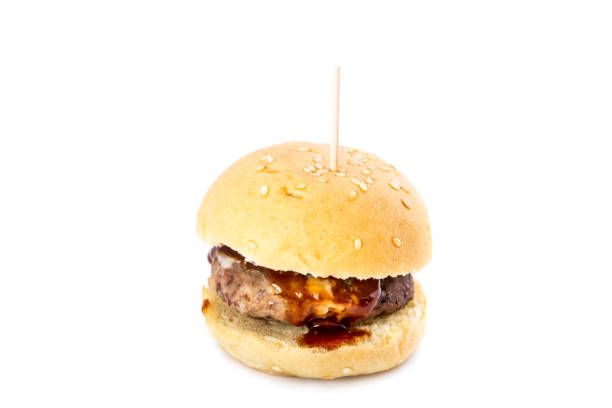 Small burger Small meat burger with barbecue sauce isolated on white background. slider burger stock pictures, royalty-free photos & images