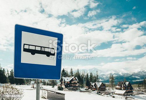 A small bus stop with a sign in Zakopane. Poland. Closeup photo