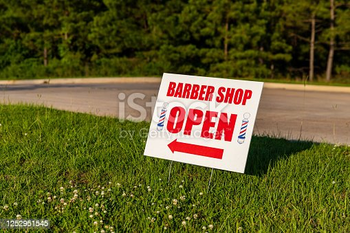 istock Small Business, bright Barber Shop Open sign, outside with copy space 1252951545