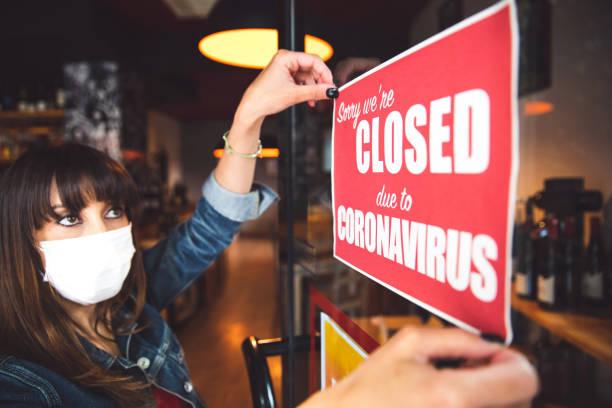 Small business closing sign due to Covid-19 coronavirus stock photo