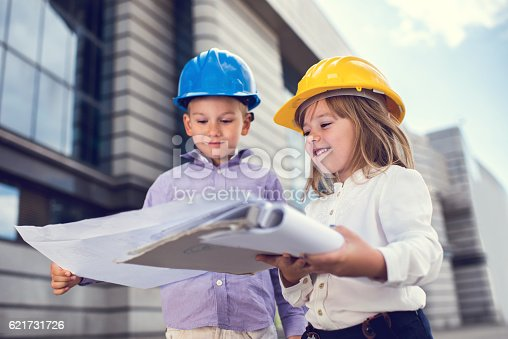 643843490istockphoto Small business contractors working on a project outdoors. 621731726