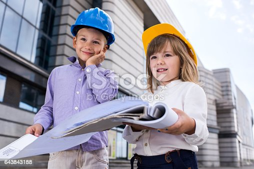 643843490istockphoto Small business contractors working on a project outdoors. 643843188