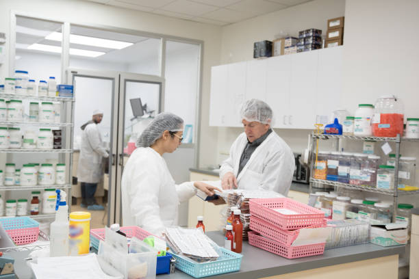 small business daily life - pharmaceutical compounding stock photos and pictures