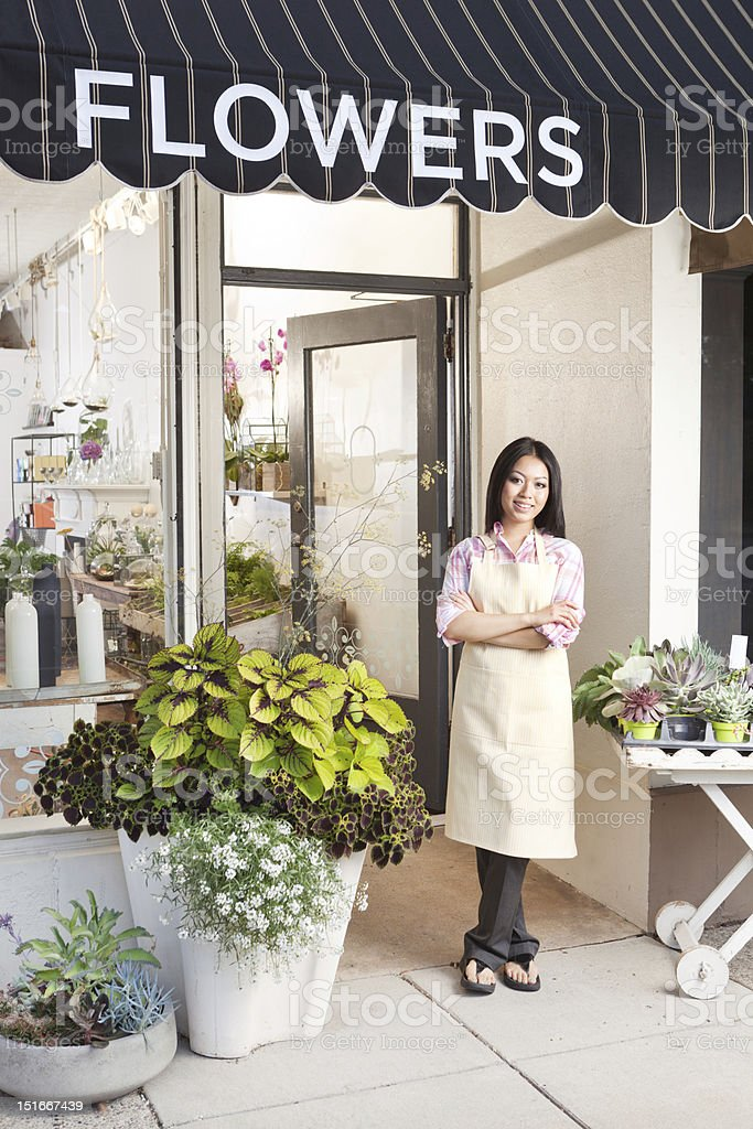 A Happy confident young woman entrepreneur business owner in front of...