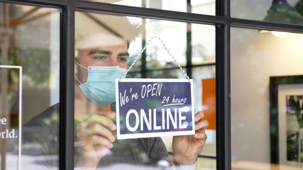 Small business going online during COVID-19 pandemic stock photo