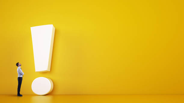 Small business man looks at a big white exclamation mark on a yellow background. 3D Rendering stock photo