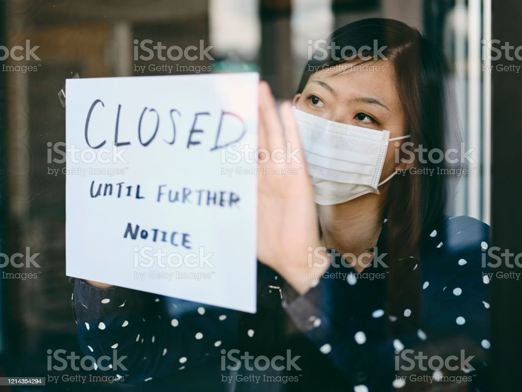 Small Business Owner Affected by COVID-19 An Asian woman small business owner affected by the COVID-19 virus. 30-39 Years Stock Photo
