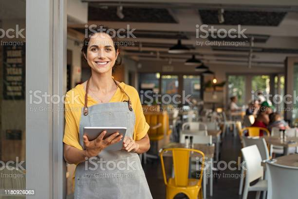 Small business owner at entrance looking at camera picture id1180926063?b=1&k=6&m=1180926063&s=612x612&h=t9vy35uuss5ypng8laczx7dagus8l13 mltbfbxrvra=