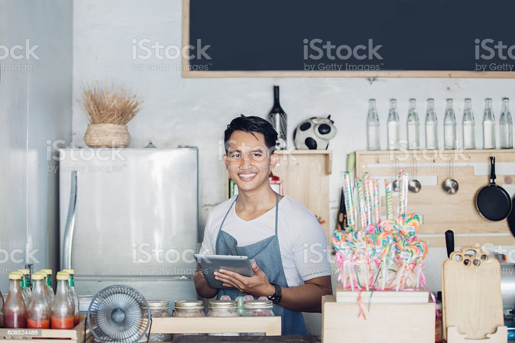 small business owner at his coffee shop stock photo