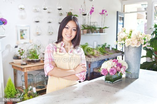 Subject,Portrait of a happy young woman entrepreneur business owner florist in her store