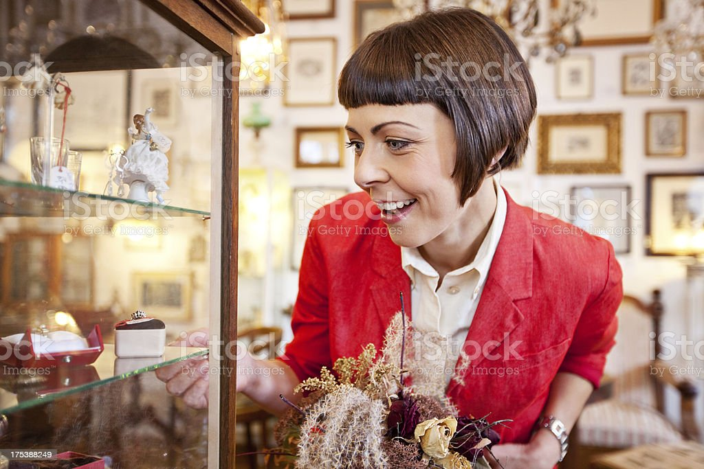 Small business owner in her antique shop stock photo