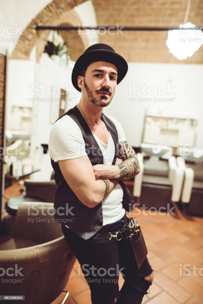 small business owner in his barber shop royalty-free stock photo