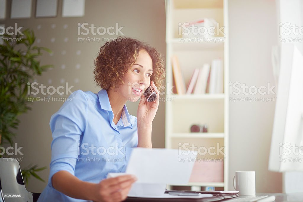 small business owner on the phone stock photo