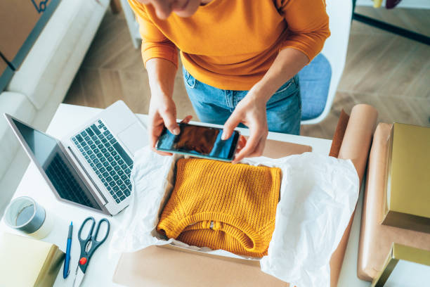 Small business owner Young woman are preparing a package for delivery to clients. Online clothing store clothes in box stock pictures, royalty-free photos & images