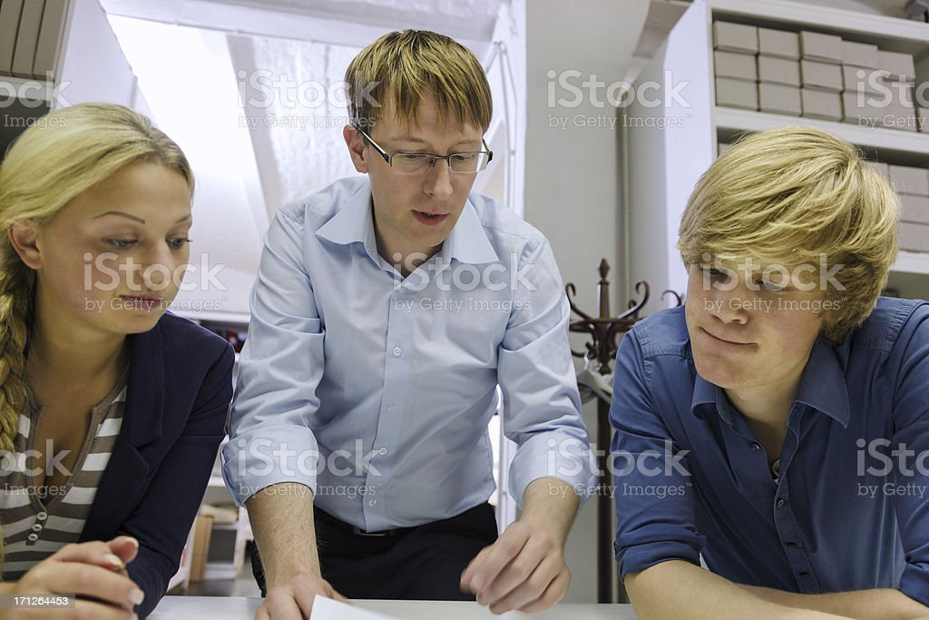 Small Business Owner with Trainees royalty-free stock photo