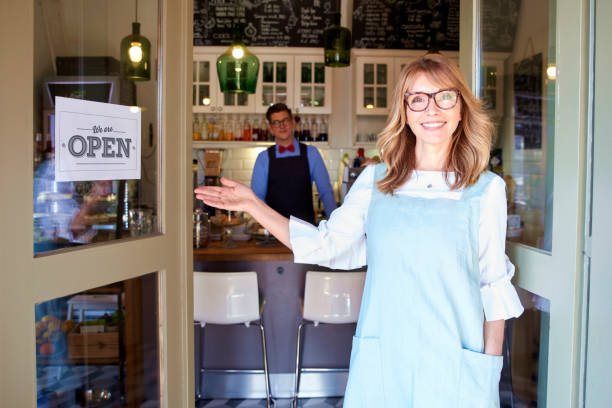 Cтоковое фото Small business owner woman standing in cafe door and smiling