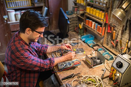 Small business owner working in his workshop