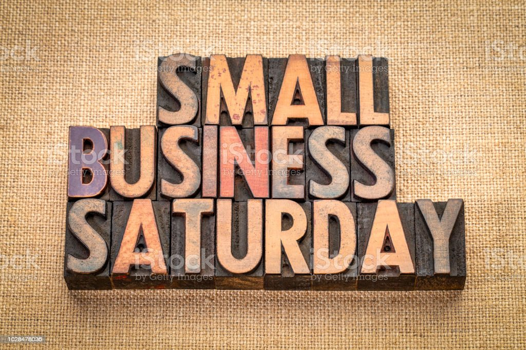 Small Business Saturday in wood type Small Business Saturday word abstract - text in vintage letterpress wood type against burlap canvas, holiday shopping concept Burlap Stock Photo