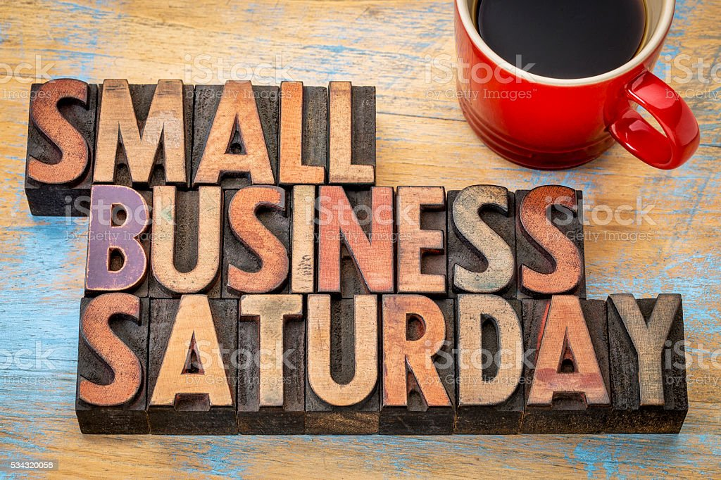Small Business Saturday in wood type Small Business Saturday word abstract - text in vintage letterpress wood type with a cup of coffee, holiday shopping concept Banner - Sign Stock Photo