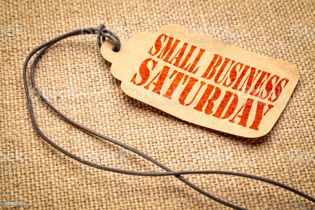 Small Business Saturday text on a price tag stock photo