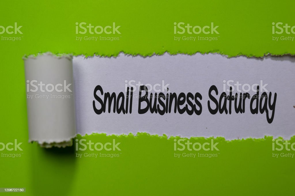 Small Business Saturday write on white and green torn paper Small Business Saturday write on white and green torn paper Abstract Stock Photo