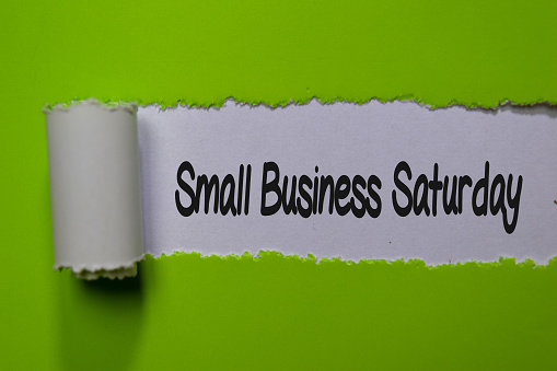 Small Business Saturday Write On White And Green Torn Paper Stock Photo - Download Image Now