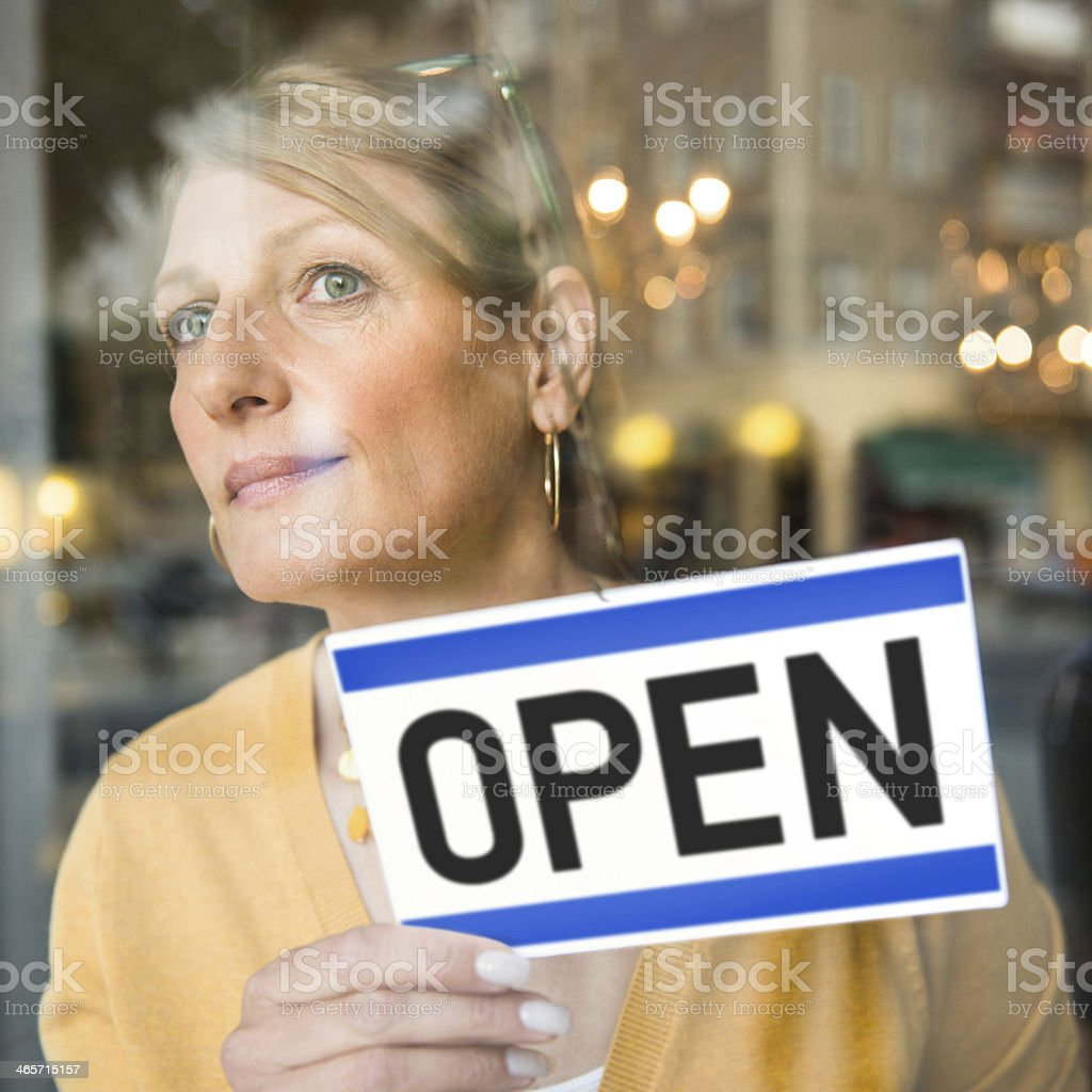 Small Business Shop Owner with OPEN Sign royalty-free stock photo