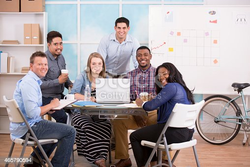 624700110istockphoto Small business, start up. Creative young adult co-workers collaborate together. 465790594