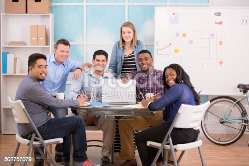 624700110istockphoto Small business, start up. Creative young adult co-workers collaborate together. 502757079