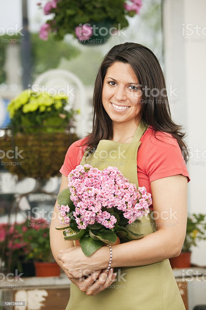 Small Business Woman Entrepreneur Owner in Retail Flower Shop royalty-free stock photo