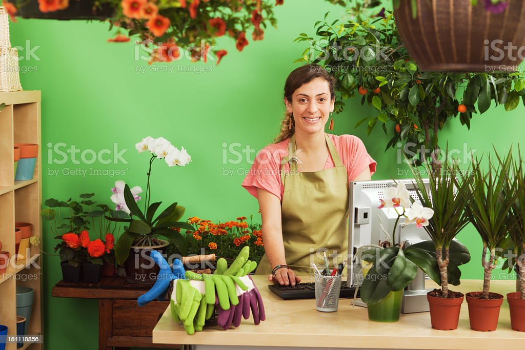 A small business owner of a retail flower shop. A Caucasian woman...
