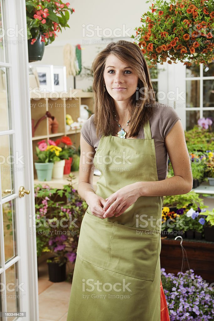 Small Business Woman Owner of Retail Flower Shop royalty-free stock photo