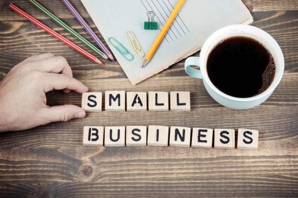 Small Business. Wooden letters on the office desk stock photo