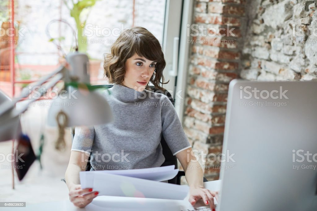 161218 Small business, working at the office. stock photo