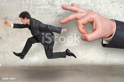 istock Small businessman running away from a boss pressure 656919994