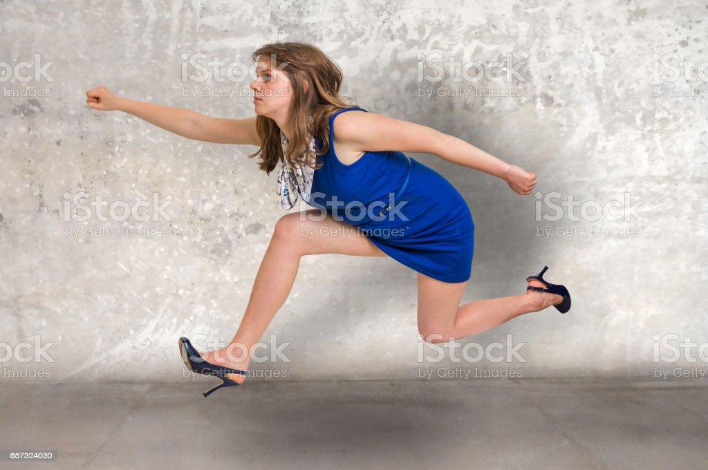 Small businesswoman running away stock photo