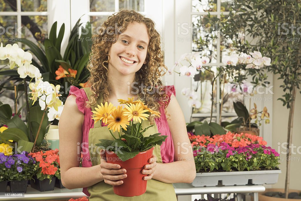 Small Business—Young Woman Florist, Worker, Owner at Flower Shop royalty-free stock photo