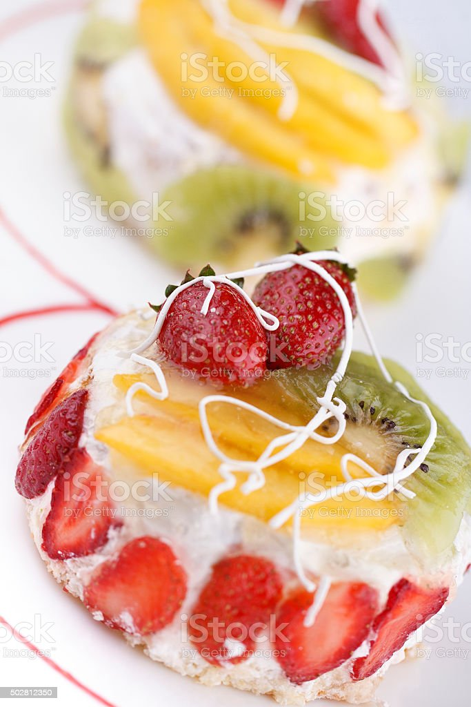 Small Cakes with fresh fruits stock photo