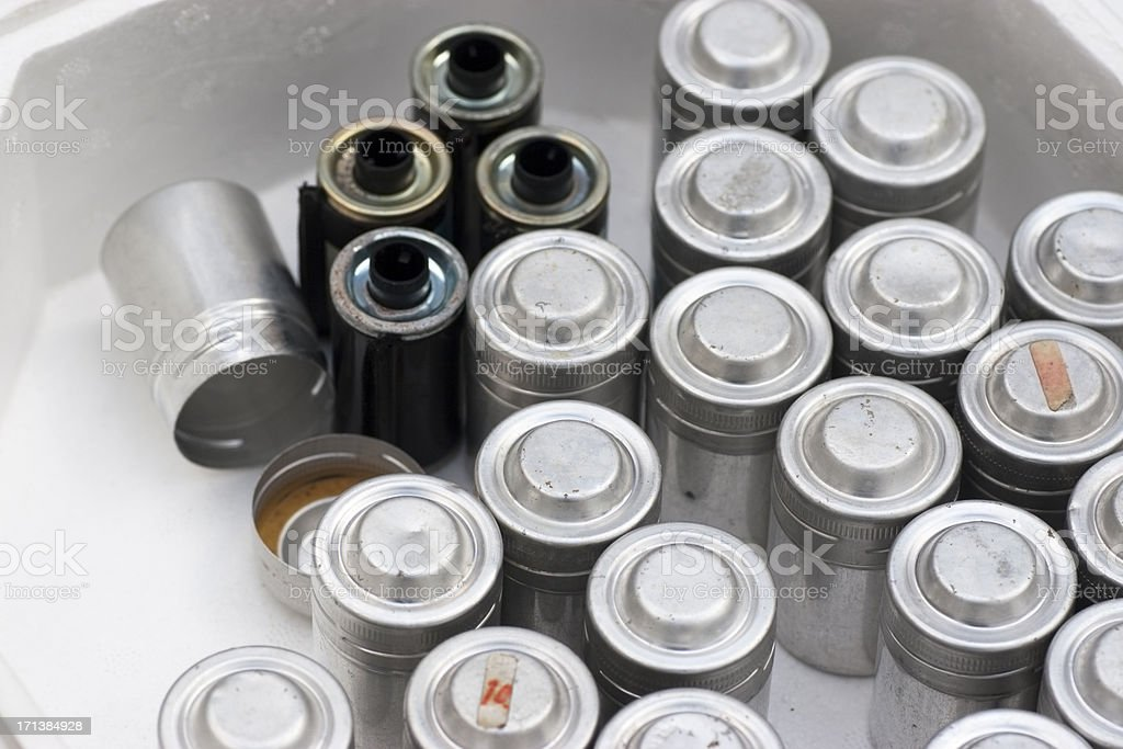 Small camera film cans in a box royalty-free stock photo
