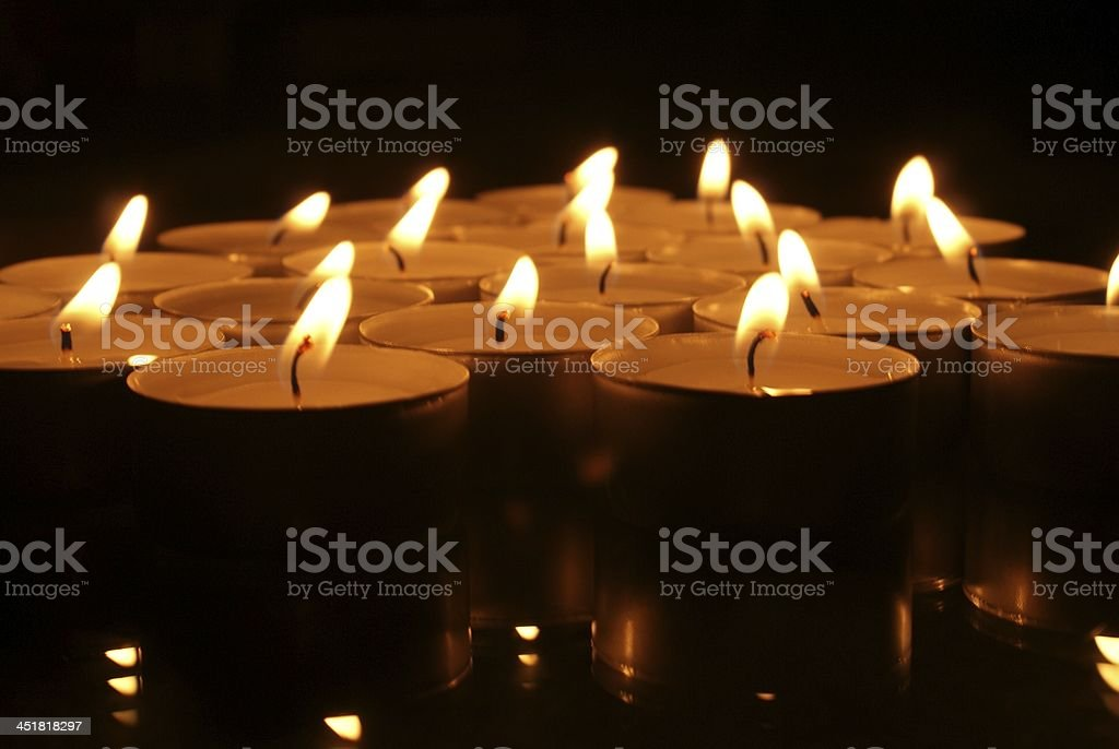 Small candles in dark stock photo