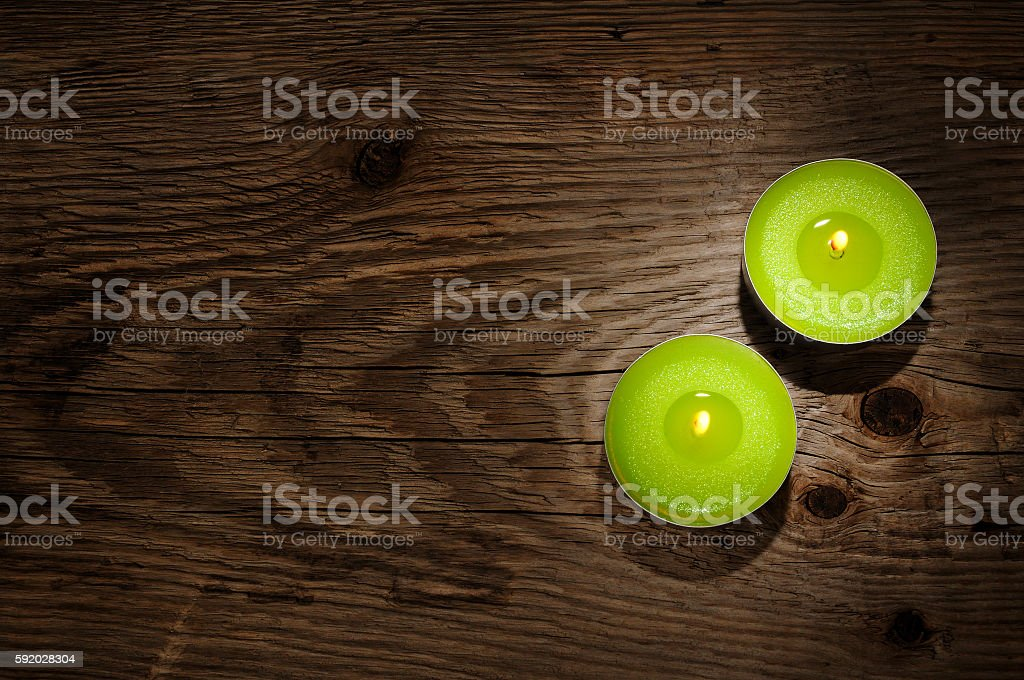 Small candles on wooden background stock photo