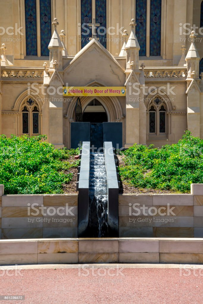 Small cascade fountain at St Mary's Cathedral front entrance at Victoria Avenue, Perth City, Western Australia stock photo