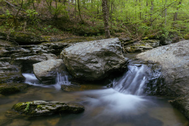 Small cascade waterfall tucked away in a North Georgia Stream stock photo