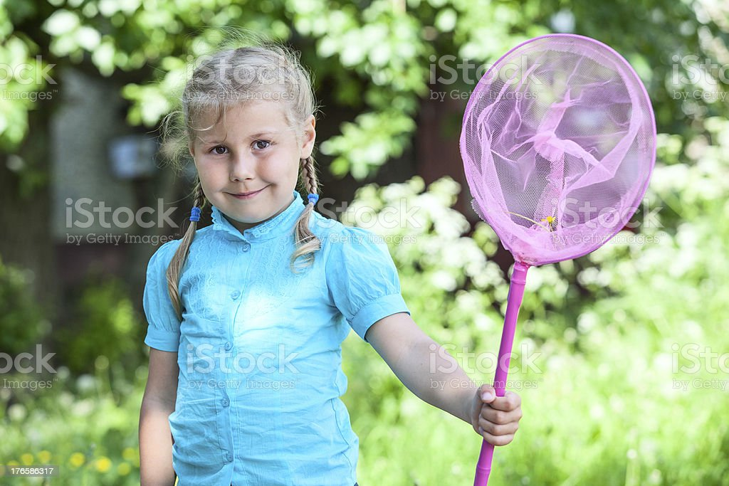 Small Caucasian girl portrait with butterfly net stock photo