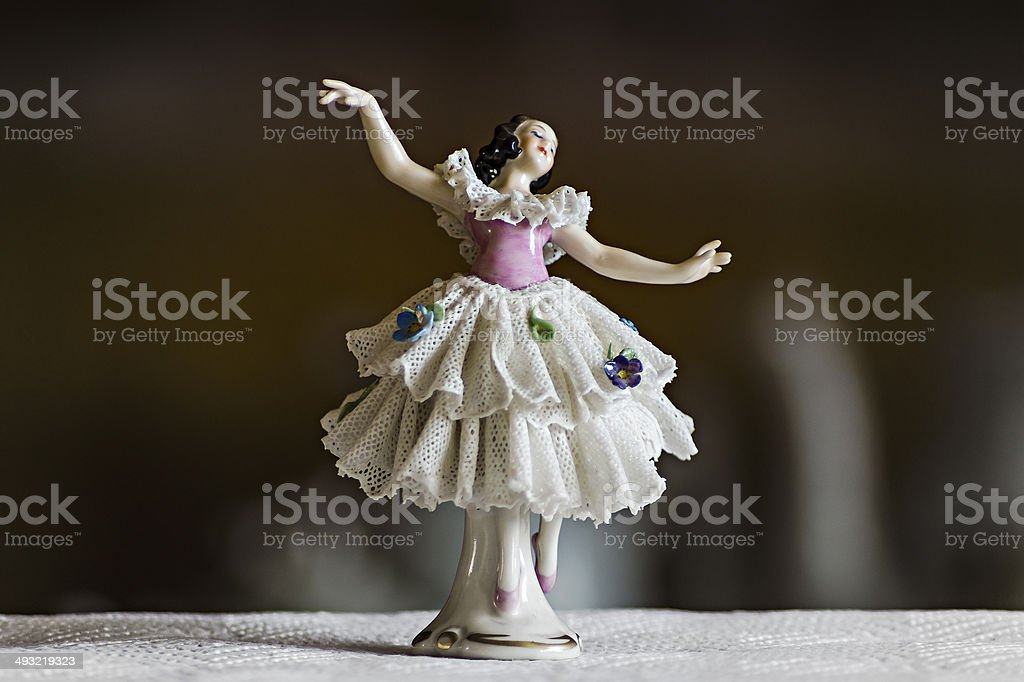 small ceramic statuette dancer stock photo