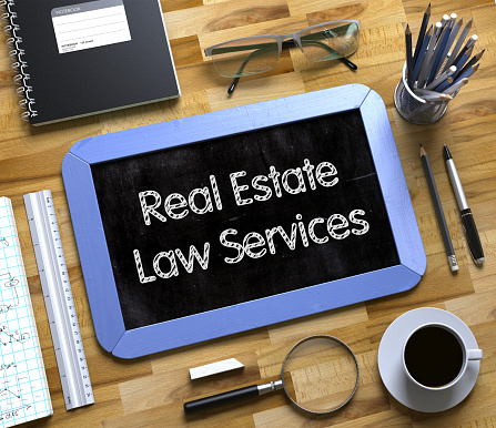 626187670 istock photo Small Chalkboard with Real Estate Law Services Concept. 3D 680754906